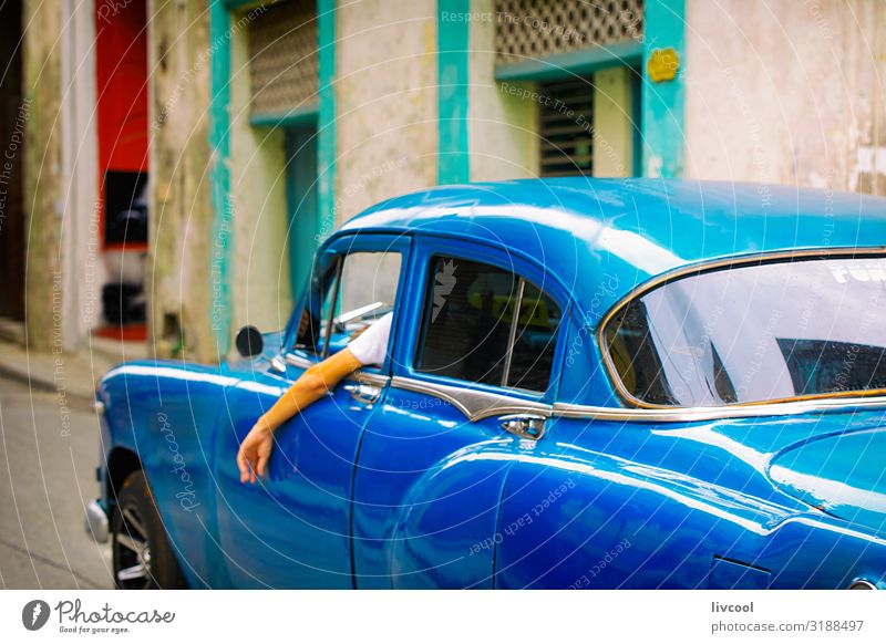 old blue car - central streets of havana , cuba Vacation & Travel Old Blue Street Lifestyle Tourism Pink Trip Rain Transport Retro Island To enjoy Driving Cuba