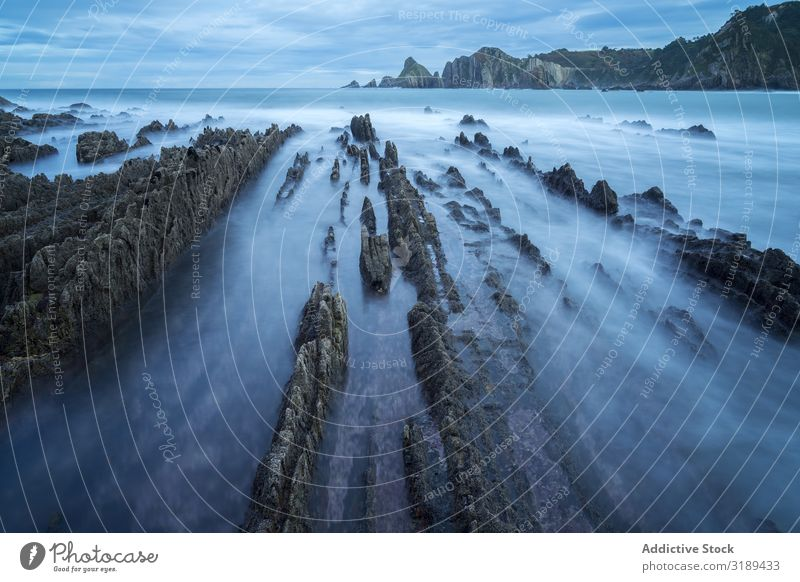 Foggy landscape of Playa de Gueirua rock seashore Landscape Coast Rock Ocean playa gueirua asturias Spain seascape Nature Water Beach Cliff coastal Beautiful