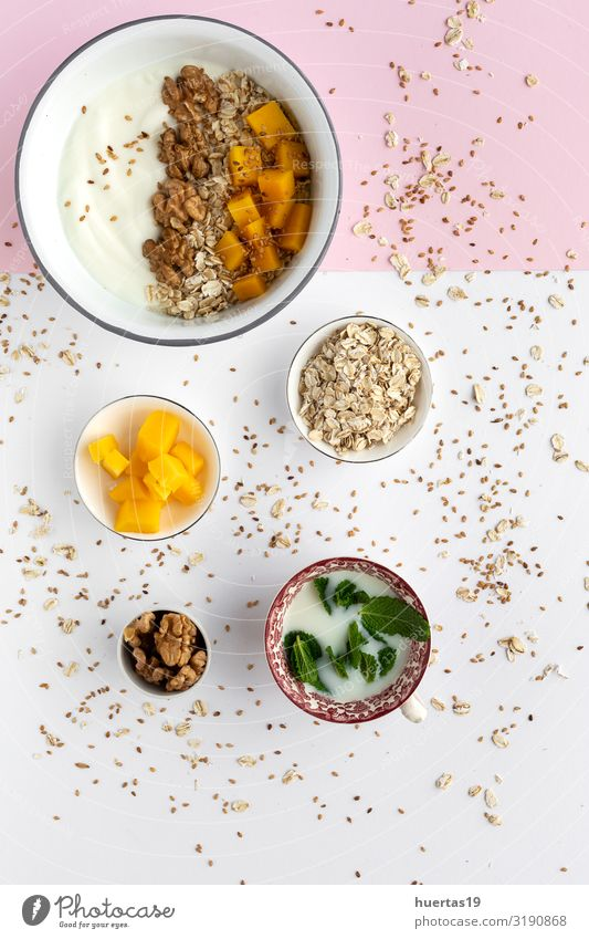 Bowl of homemade granola with yogurt and cereals Food Yoghurt Fruit Nutrition Breakfast Vegetarian diet Diet Spoon Lifestyle Healthy Eating Fresh Delicious