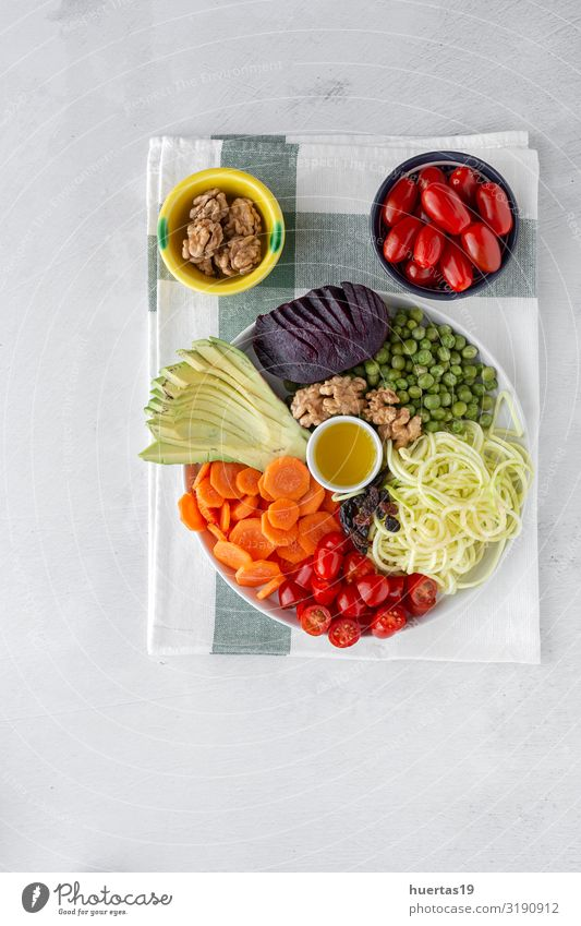 Raw vegan salad with assorted vegetables Food Vegetable Lunch Dinner Vegetarian diet Diet Healthy Eating Kitchen Wood Fresh Delicious Above Green White Zucchini