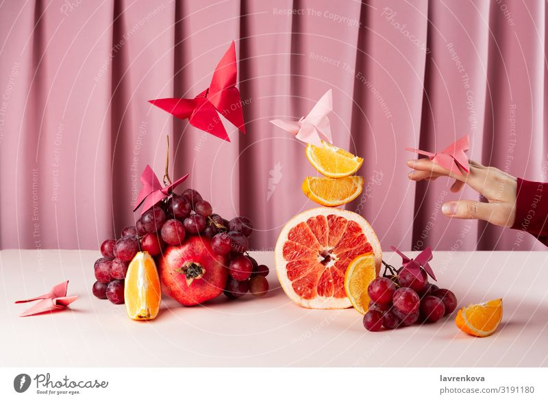 Various fruits on pink table with origame paper butterflies Breakfast Lemon Citrus fruits Diet Food Healthy Eating Food photograph Fresh Fruit Glass Grapefruit