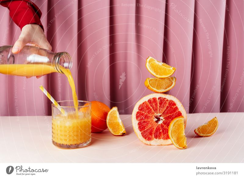 Woman pouring juice into the cup on the table with citrus fruits Beverage Breakfast Circus Lemon Citrus fruits Cocktail Diet Drinking Food Healthy Eating