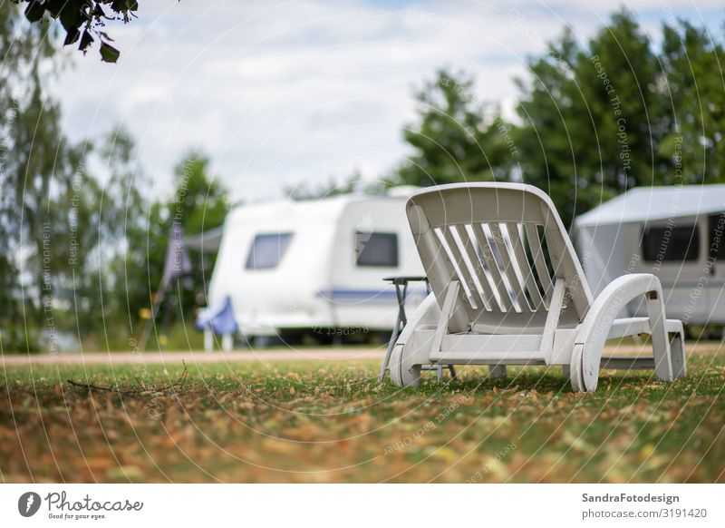 White deckchair in a meadow at a campsite Lifestyle Relaxation Leisure and hobbies Vacation & Travel Camping Garden Nature Park camping prak camping site chairs