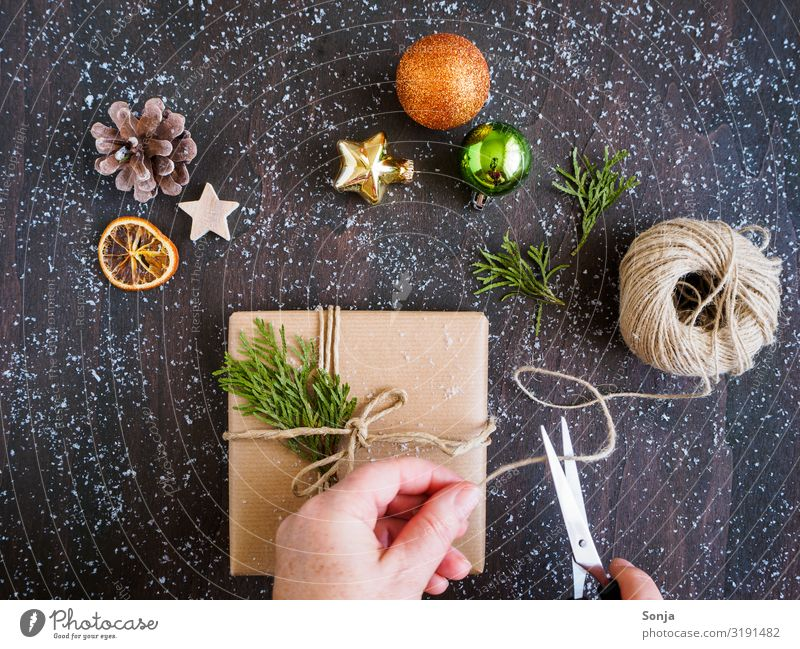 Woman wrapping a gift, Christmas decoration Leisure and hobbies Christmas & Advent Birthday Feminine Adults Life Hand 1 Human being 45 - 60 years Package