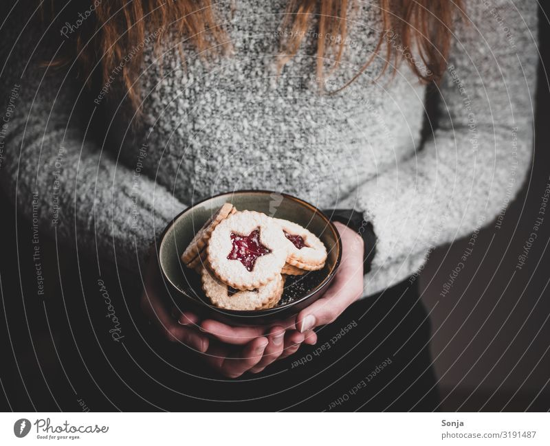 Woman holding Christmas cookies in a bowl in her hands Food Dough Baked goods Dessert Cookie Nutrition To have a coffee Bowl Lifestyle Christmas & Advent
