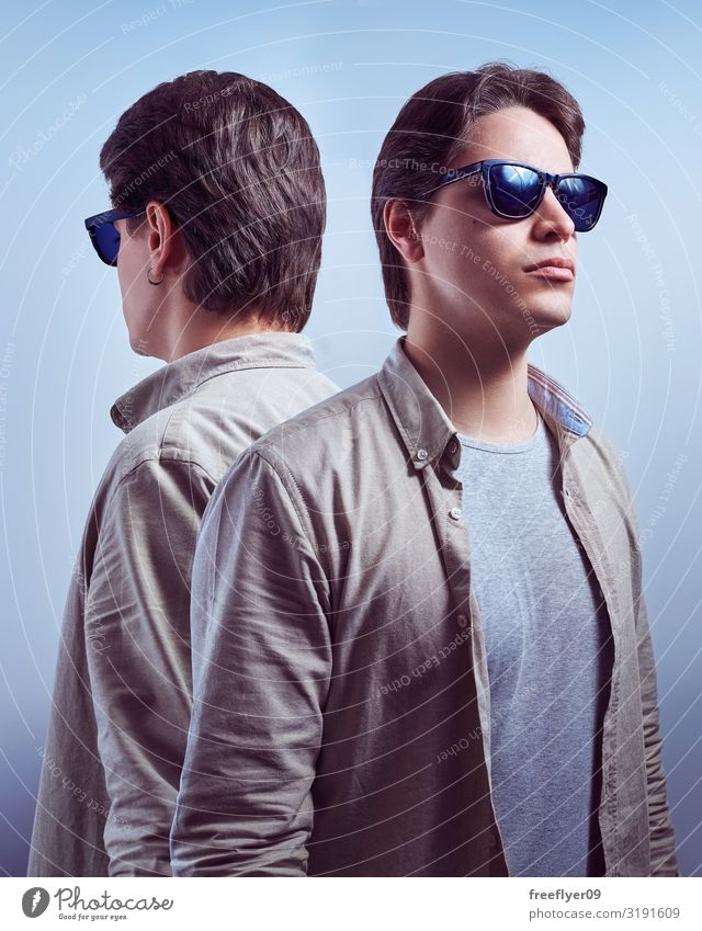 Portrait of a man in sunglasses and his reflection Human being Man Blue Beautiful White Eroticism Face Lifestyle Adults Natural Fashion Modern Smiling
