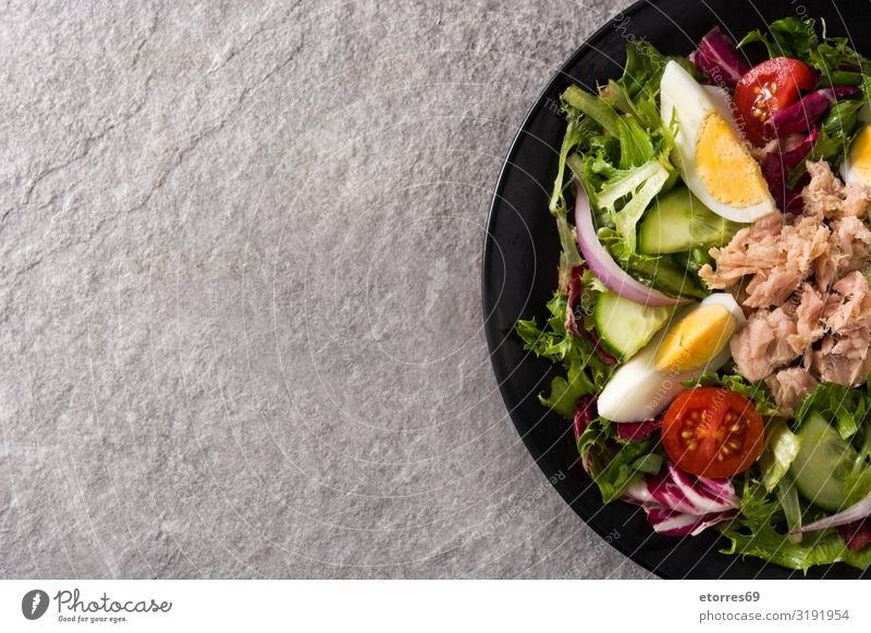 Salad with tuna, egg and vegetables Vegetable Tuna fish Egg Tomato Lettuce Black Plate Onion Cucumber Slice Mixed Olive oil Healthy Eating Food Food photograph