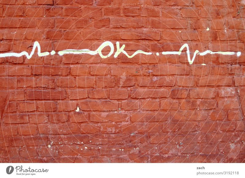 Okay Small Town Downtown Old town House (Residential Structure) Wall (barrier) Wall (building) Facade Brick Sign Characters Signs and labeling Graffiti Happy