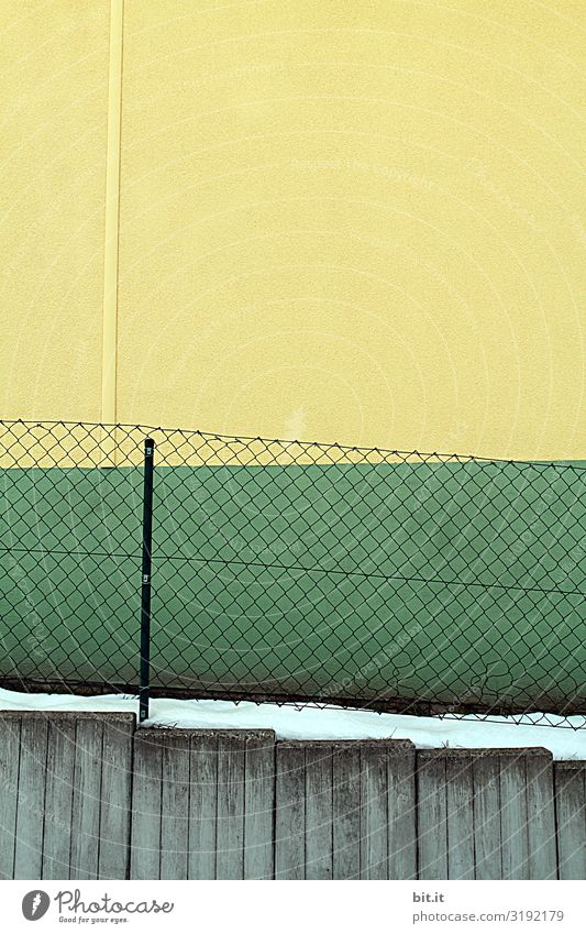 Fence and facade in green - yellow Art Environment Snow Architecture Wall (barrier) Wall (building) Facade Line Stripe Net Sharp-edged Clean Trashy Gloomy