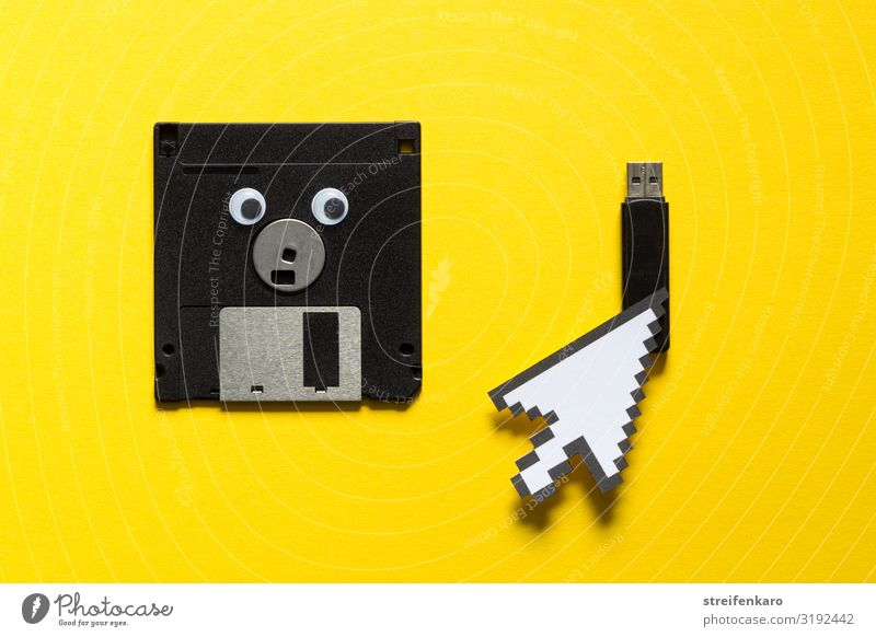A discarded floppy disk looks wistfully at the USB stick, which the mouse pointer prefers Office work Media industry Computer Notebook Computer mouse Software