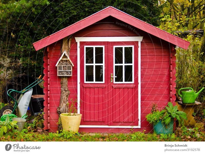 A bright red garden shed Healthy do gardening Living or residing Nature Autumn Plant Tree Flower Hut Garden Decoration Gardening equipment Wheelbarrow