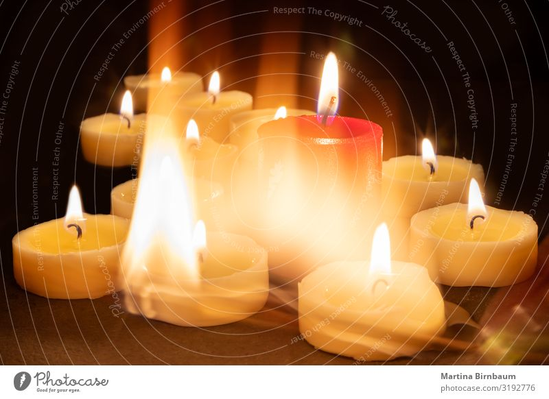 Playing with fire and candles Red Dark Black Warmth Religion and faith Feasts & Celebrations Candle Symbols and metaphors Grief Longing Peace Monument