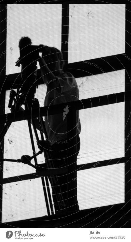 cameraman 1 Window Video Camera-man Man Television Black & white photo