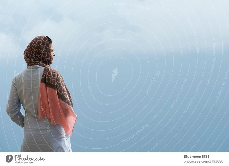 Profile view of a young Muslim woman looking to the right Woman Human being Vacation & Travel Nature Youth (Young adults) Young woman Blue Beautiful Landscape