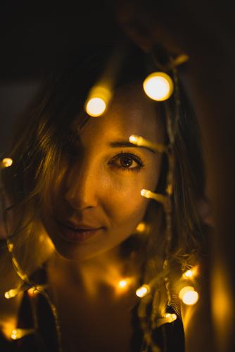 Woman surrounded with light garland Paper chain Light Attractive romantic Youth (Young adults) Beautiful Bed Vacation & Travel Christmas & Advent Happy Night