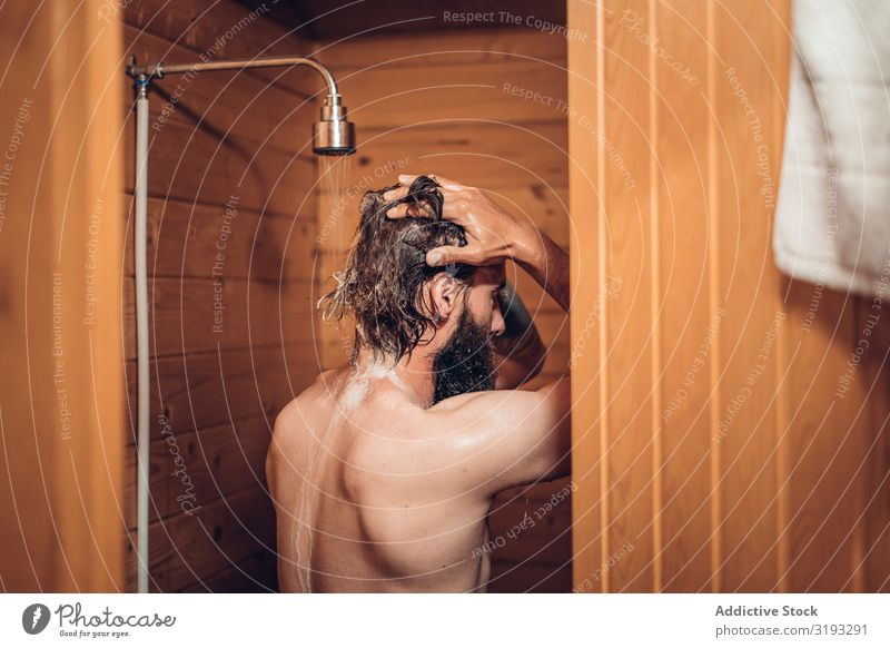 Man taking shower in wooden bathroom Take Take a shower Bathroom Water Wet Clean Considerate Healthy Hipster Human being handsome Morning Fresh bearded Washing