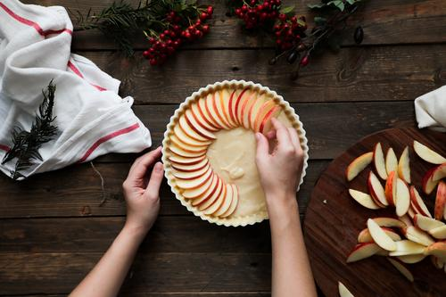 unrecognizable woman making a apple pie on a wooden table Pie Apple Fresh Wood Rustic Window Home-made Day Brown Confectionary Organic parchment Warmth Aromatic