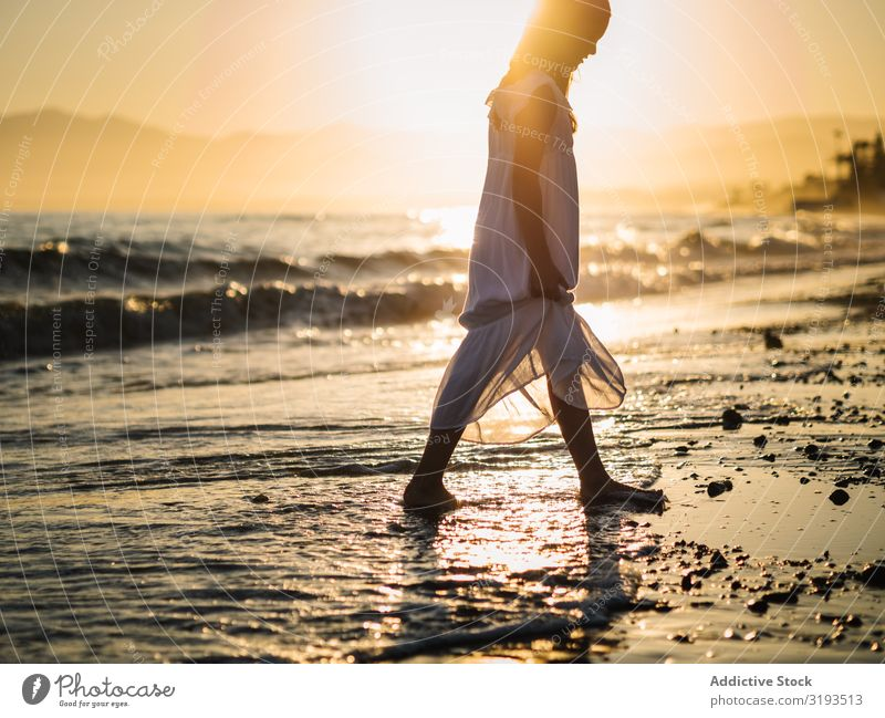 Adorable girl walking on seaside at sunset Girl Sunset Walking Delightful Coast Beach Summer Water Ocean Sunbeam Child Infancy Happy Happiness Vacation & Travel