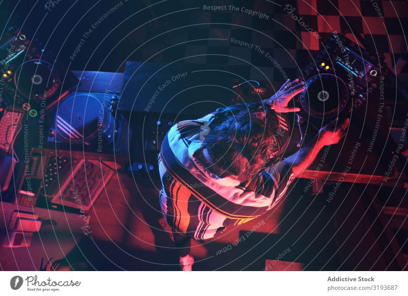 From above an anonymous dj man playing in a club with lights Nightclub Hand Entertainment Record Playing Equipment Turntable Party disc Background picture Club