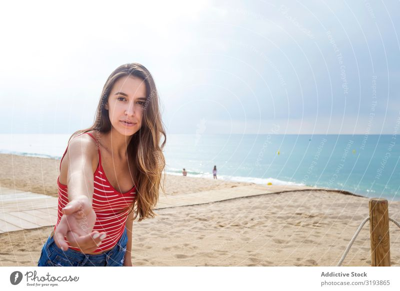 Portrait of beautiful young woman hand reaching towards the camera at beach Beautiful Youth (Young adults) Woman Beach Brunette Hand Girl Ocean Exterior shot