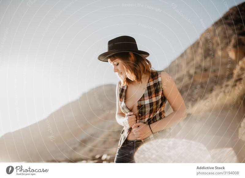 Sensual woman posing on seashore Woman Posture Coast To enjoy Mountain Ocean Sunbeam Day unbuttoned Shirt Breasts Harmonious Idyll Lifestyle Leisure and hobbies