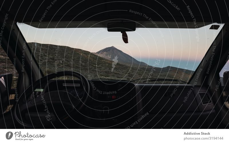View of mountain through window of car Mountain Desert Car Window Picturesque Peak Tenerife Spain Remote through glass Area Morning road trip Traveling Tourism