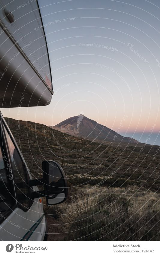 Camper car against remote mountain Mobile home Mountain Dawn Car Vacation & Travel Remote Wild Peak Sky Tenerife Spain Morning Gray Parked Vantage point Tourism