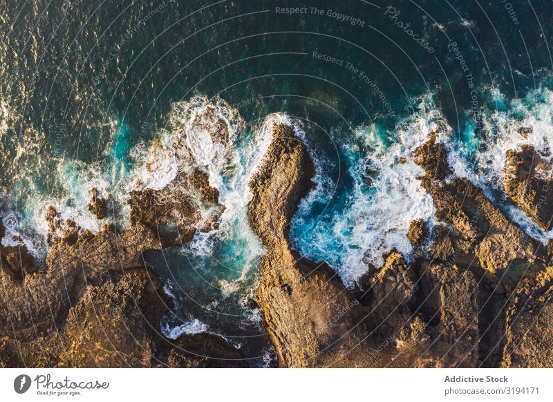 Drone view of coast with cliffs Coast Cliff Waves drone view Rock Splashing Remote Aircraft foamy Day Spain Tenerife Water Height Ocean Landscape Nature