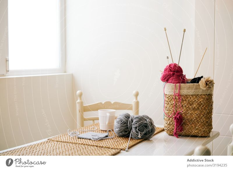 Mug of tea near knitting supplies Knit yarn The Needles Tea Table Cozy Room Basket Leisure and hobbies Warmth Drinking Beverage Hot brewed Supplies tools