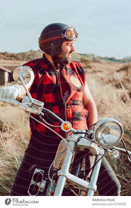 bearded adult man sitting on motorcycle on seashore Man Motorcycle Beach Ride Ocean Coast Brutal Contemporary Trip Vehicle Child Recklessness Vacation & Travel