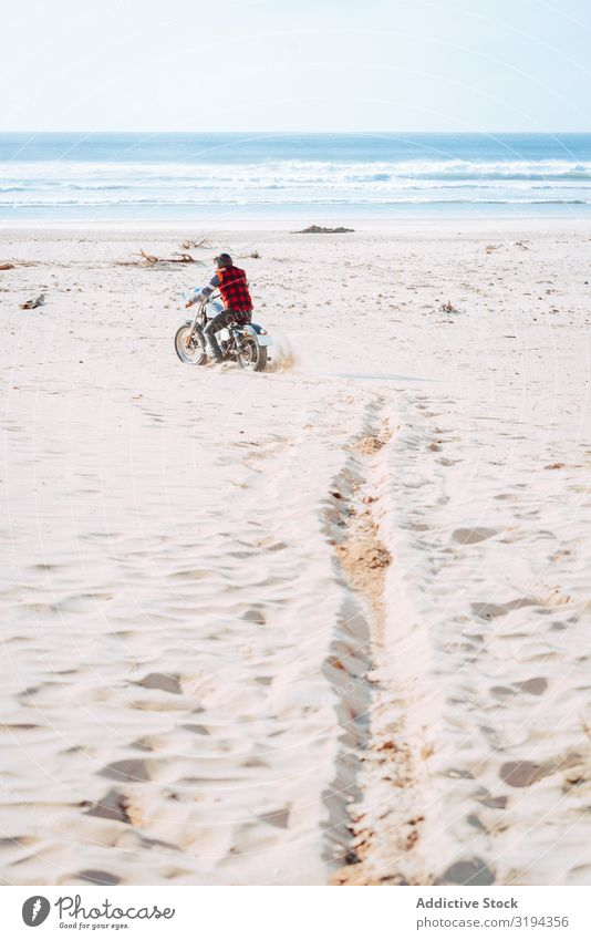 Man riding motorcycle on ocean seashore Motorcycle Beach Ocean explore Ride Drive Nature Vacation & Travel Adventure Remote Transport Tourism Trip Harmonious