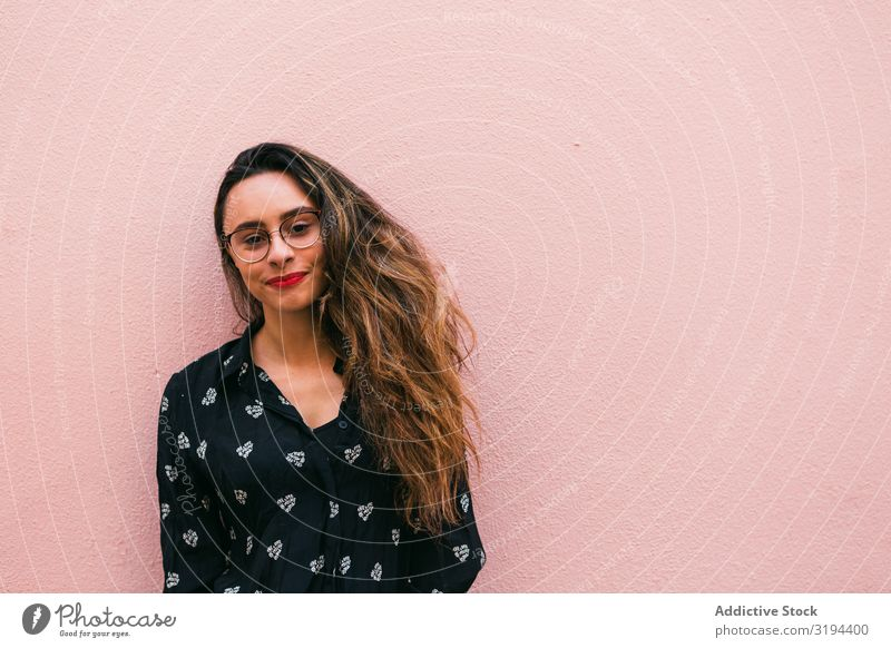 Smiling young woman against pink wall Woman Youth (Young adults) Happy Easygoing Portrait photograph Cheerful Person wearing glasses Emotions Expression
