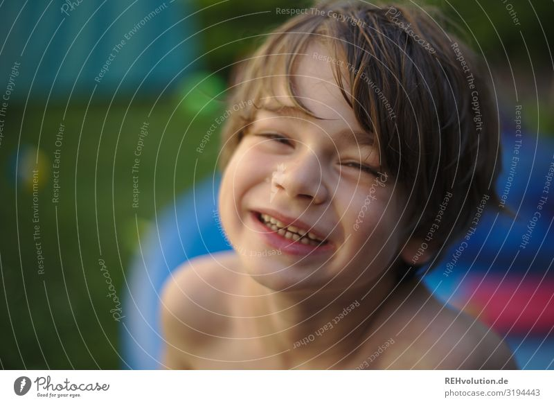 Boy laughing in the garden Boy (child) 7 years fortunate Happy cooling warm Joie de vivre (Vitality) Joy portrait Face Looking into the camera Front view