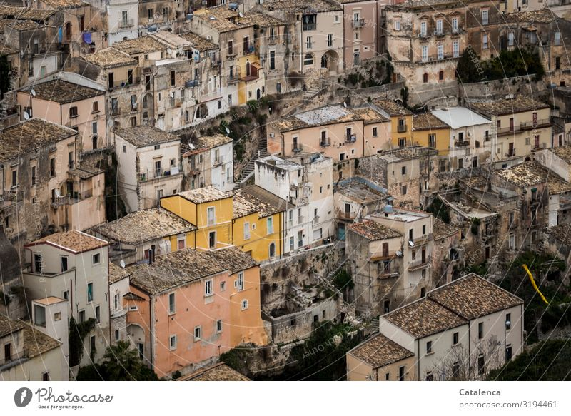 Neighborhoods in a confined space Architecture Flat (apartment) houses Village Town Building Facade Window Roof Manmade structures Living or residing Street Old