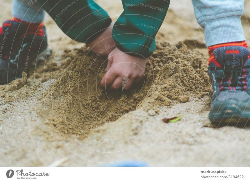 Boy digging in the sandbox Joy Happy Contentment Playing Garden Parenting Kindergarten Child Sandpit Playground Muding Human being Boy (child) Infancy Hand