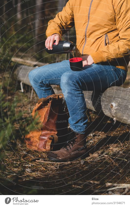 tea break Hot drink Masculine 1 Human being Hiking Nature Forest Sit Exterior shot Break Tea Thermos coffee pot Pour Unload Heat Tree trunk Backpack Trip