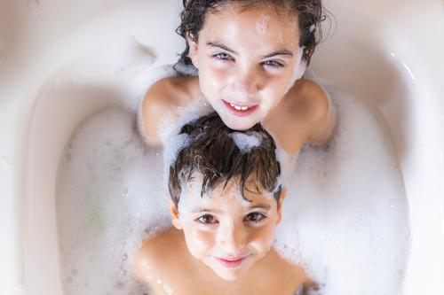 Two kids taking a bath looking a camera Child Human being Naked Beautiful Joy Lifestyle Funny Family & Relations Happy Boy (child) Swimming & Bathing Friendship