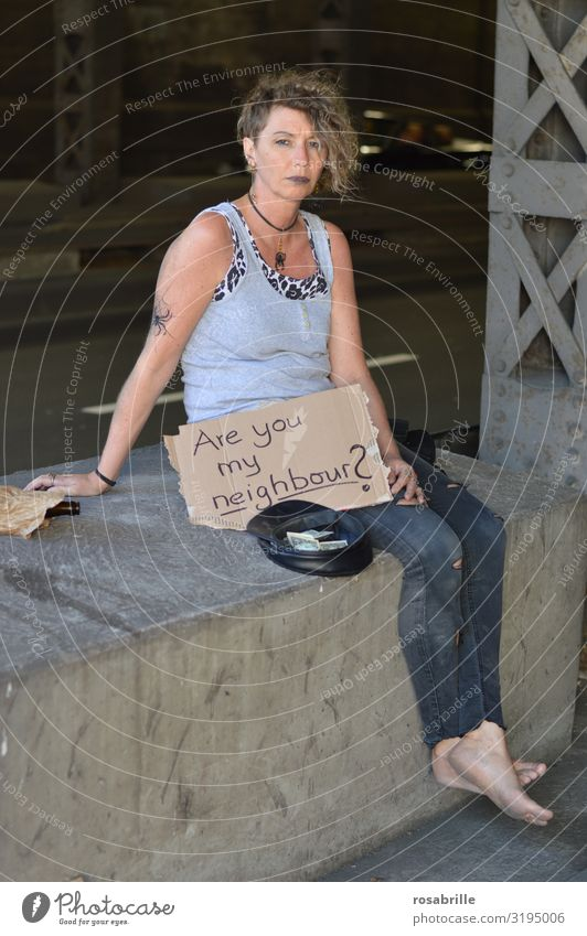 Begging punk sits under bridge with sign ARE YOU MY NEIGHBOUR ? Alcoholic drinks Money Intoxicant Unemployment Woman Adults Subculture Punk Bridge Street Tattoo