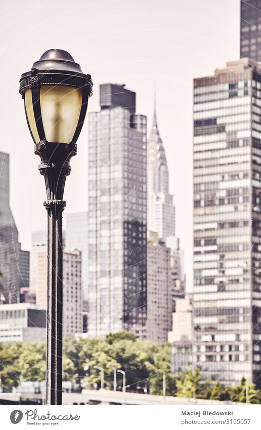 Street lamp with New York blurred skyline in background. Vacation & Travel Sightseeing City trip Sky Small Town Skyline High-rise Building Architecture Retro