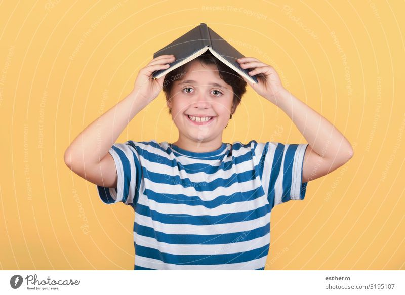 happy child with book on head Child Human being Joy Lifestyle Funny Emotions Laughter Playing School Masculine Smiling Infancy Happiness Study Book Idea