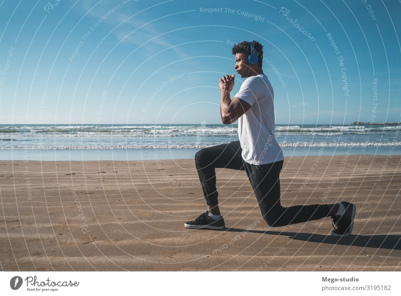 Athletic man doing exercise at the beach. Personal hygiene Body Relaxation Leisure and hobbies Beach Sports Jogging Work and employment Human being Man Adults