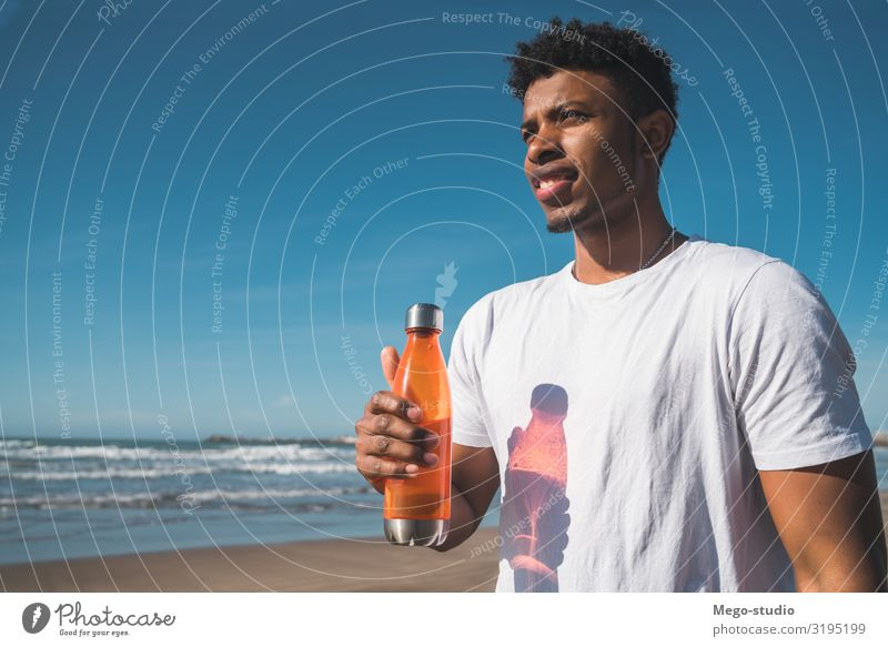 Athletic man with a bottle of water. Drinking Lifestyle Style Leisure and hobbies Beach Sports Human being Masculine Man Adults Sand Fitness Muscular Strong