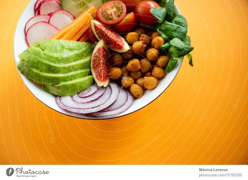 Buddha bowl wirh avocado, figs, chickpeas and carrot. Vegetable Diet Bowl Fresh egg healthy Copy Space Fig wood cucumber Seasons Spinach Meal buddha bowl Salad