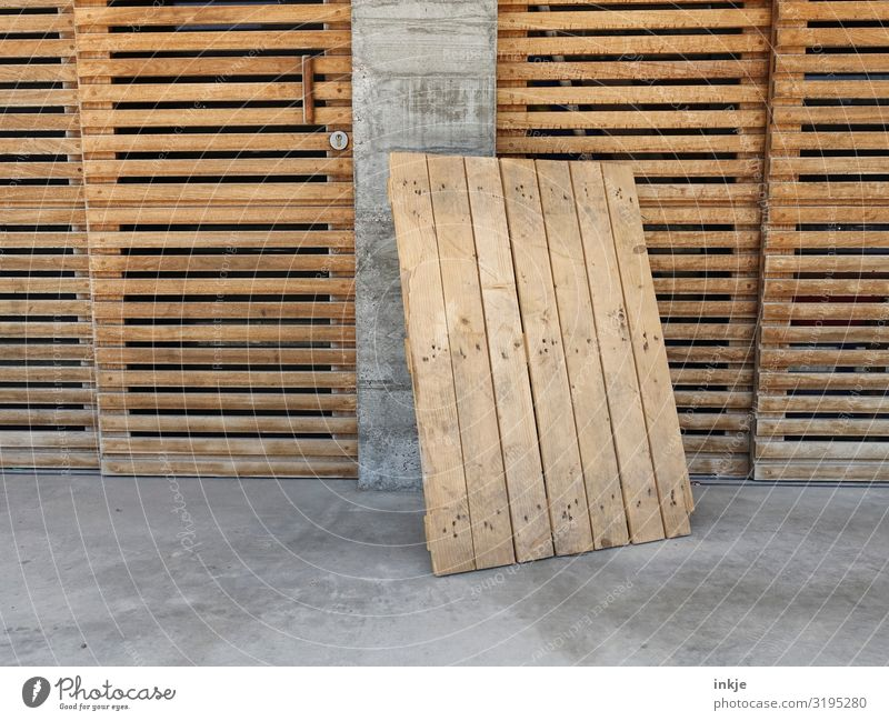 Wood and concrete Work and employment Deserted Facade Door Wooden gate Wall panelling Wooden board Palett Concrete Brown Gray Ajar Parking Closed Colour photo