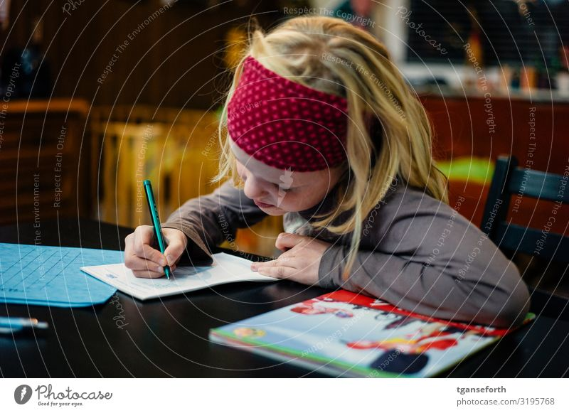 Child writing Parenting Education School Study Student Homework Feminine Girl Infancy 1 Human being 3 - 8 years Stationery Paper Piece of paper Pen Write