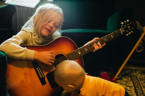 Sister and brother playing with a guitar Playing Human being Masculine Feminine Child Toddler Girl Boy (child) Brothers and sisters Family & Relations Infancy 2