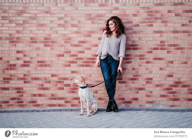 young woman and her dog at the city. standing by a brick wall Portrait photograph Woman Dog Park Youth (Young adults) Exterior shot Love Pet owner Beautiful