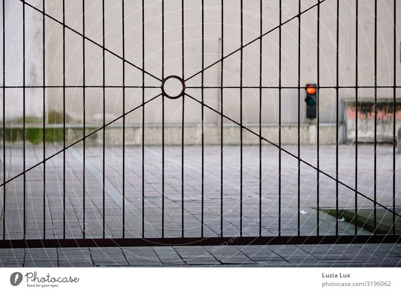 Iron gate, red traffic light Deserted Industrial plant Factory Gate Wall (barrier) Wall (building) Traffic light Concrete Steel Gray Red Closed Colour photo