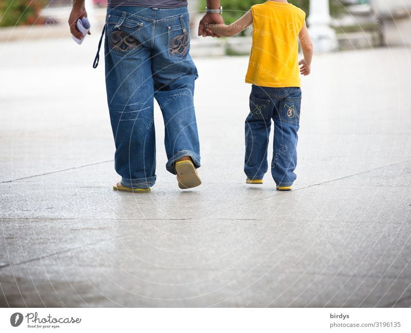 Father and son Lifestyle Masculine Child Boy (child) Adults Infancy 2 Human being 3 - 8 years 18 - 30 years Youth (Young adults) 30 - 45 years Summer Town Jeans