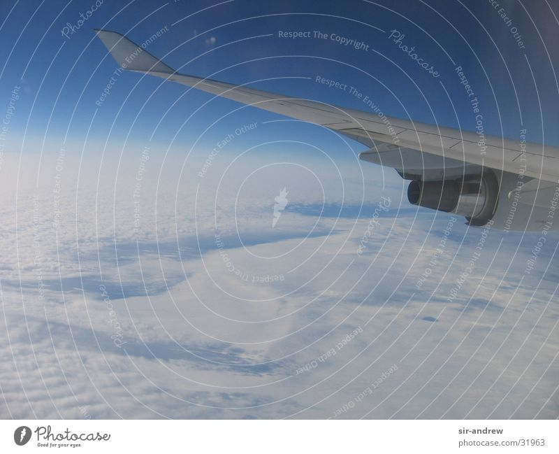 over the clouds... Airplane Clouds Engines White Sky Vantage point Blue View from a window Aerial photograph Atmosphere Wing Horizon Earth Cloud cover